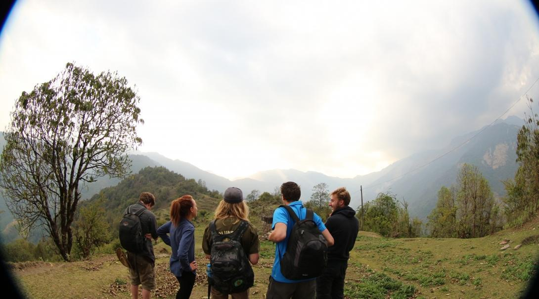 Projects Abroad volunteers take a quick break and take in the view whilst participating in conservation work in the Himalayas in Nepal.